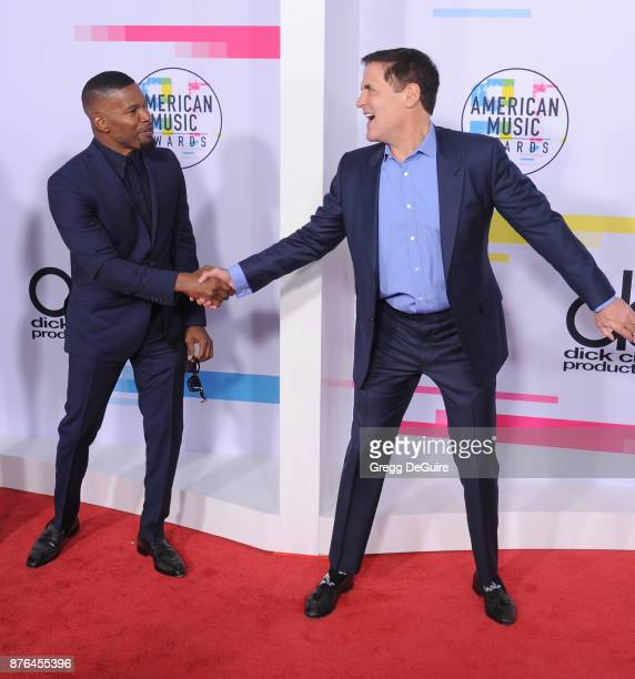 Jamie Foxx and Mark Cuban arrive at the 2017 American Music Awards at Microsoft Theater on November 19 2017 in Los Angeles California