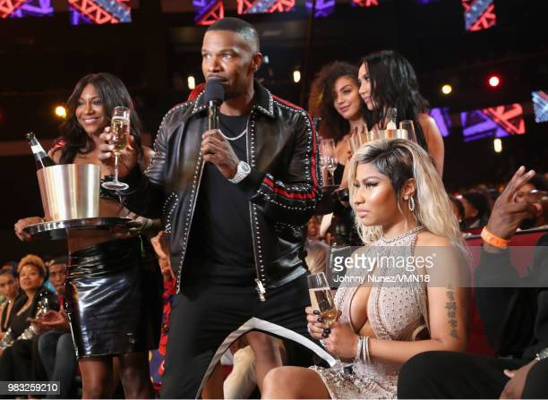 Jamie Foxx and Nicki Minaj onstage at the 2018 BET Awards at Microsoft Theater on June 24 2018 in Los Angeles California