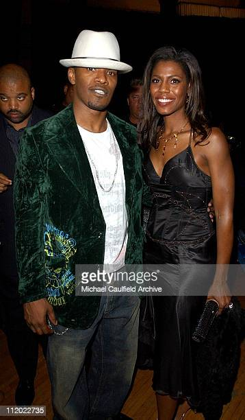 Jamie Foxx and Omarosa ManigaultStallworth during 32nd Annual American Music Awards After Party Sponsored by FHM Magazine at Shrine Auditorium in Los...