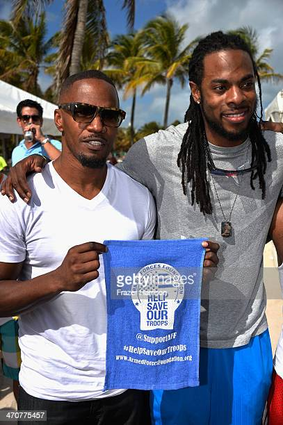Jamie Foxx and Richard Sherman attend Sports Illustrated Swimsuit Beach Volleyball Tournament on Ocean Drive at Miami Beach on February 20 2014 in...