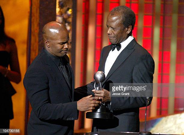Jamie Foxx and Sidney Poitier during The 36th Annual NAACP Image Awards Show at Dorothy Chandler Pavillion in Los Angeles California United States