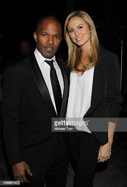 Jamie Foxx and Stacy Keibler attend the Jamie Foxx hosts The Second Annual Friday Night PreGRAMMY Soiree held at the Viceroy Hotel on February 11...
