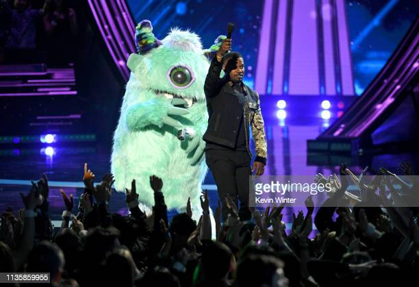 Jamie Foxx and T Pain dressed as a monster character speak on stage at the 2019 iHeartRadio Music Awards which broadcast live on FOX at the Microsoft...