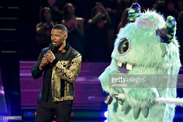 Jamie Foxx and T Pain dressed as a monster character speak on stage at the 2019 iHeartRadio Music Awards which broadcasted live on FOX at the...