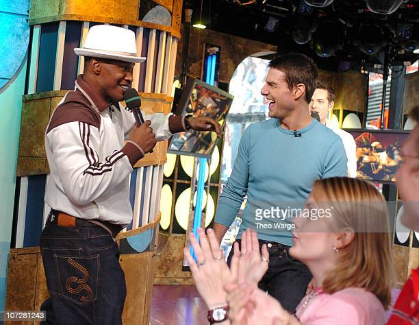 Jamie Foxx and Tom Cruise during Tom Cruise Jamie Foxx and Jada Pinkett Smith Visit MTV's TRL August 5 2004 at MTV Studios Times Square in New York...