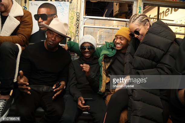 Jamie Foxx Caleb McLaughlin Terrance J and Jasmine Sanders attend Jamie Foxx InStore Shopping Event at Prive Revaux on January 26 2018 in New York...