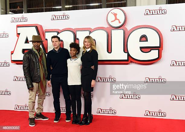 """Jamie Foxx, Director Will Gluck, Quvenzhane Wallis and Cameron Diaz attend a photocall for """"Annie"""" at Corinthia Hotel London on December 16, 2014 in..."""