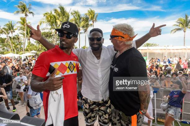 Jamie Foxx DJ Irie and Guy Fieri on stage during the Sprint IWXIV BBQ Beach Bash and Concert at the Fontainebleau Miami Beach on June 30 2018 in...