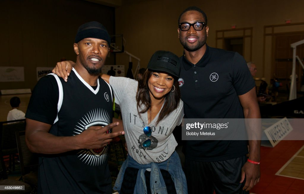 Jamie Foxx, Gabrielle Union and Dwyane Wade share a moment during Dwyane Wade's Fourth Annual Fantasy Basketball Camp at Westin Diplomat on August 1, 2014 in Hollywood, Florida.