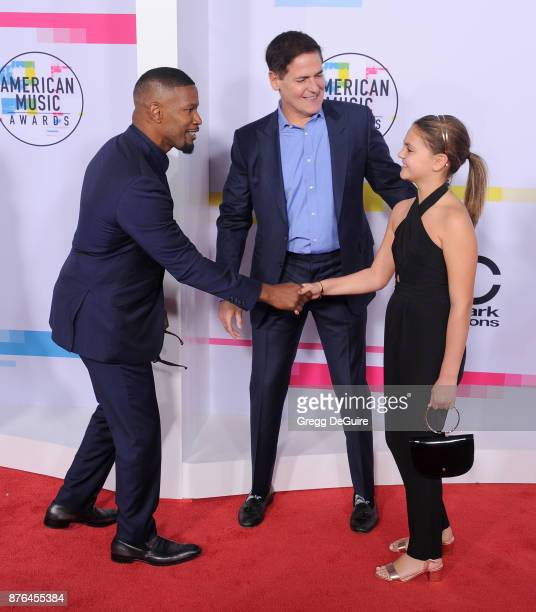 Jamie Foxx Mark Cuban and Alyssa Cuban arrive at the 2017 American Music Awards at Microsoft Theater on November 19 2017 in Los Angeles California