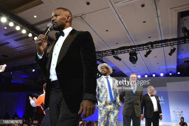 Jamie Foxx on the runway with Denver Broncos Player Von Miller actor John McGinley and 2017 Fashion Show chair Peter Kudla at the Global Down...
