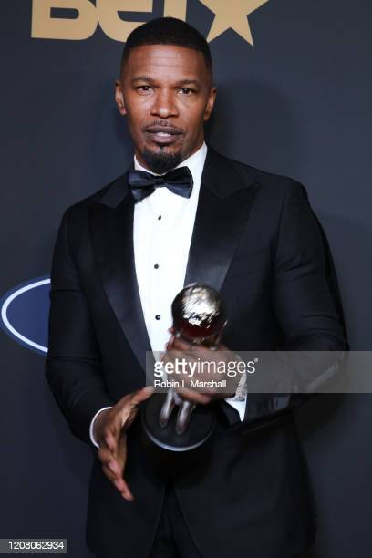 Jamie Foxx poses with the Outstanding Supporting Actor in a Motion Picture award for Just Mercy at the 51st NAACP Image Awards Presented by BET at...