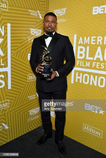 Jamie Foxx poses with with the Excellence in the Arts Award backstage during the American Black Film Festival Honors Awards Ceremony at The Beverly...