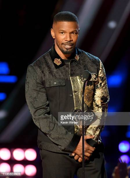 Jamie Foxx speaks on stage at the 2019 iHeartRadio Music Awards which broadcast live on FOX at the Microsoft Theater on March 14 2019 in Los Angeles...