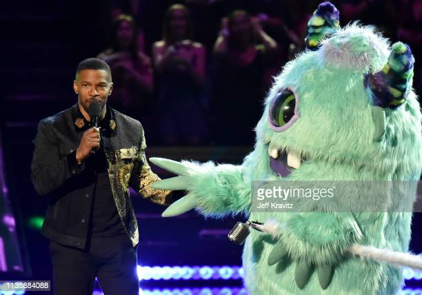 Jamie Foxx speaks while T Pain dressed as a monster character appears on stage at the 2019 iHeartRadio Music Awards which broadcasted live on FOX at...