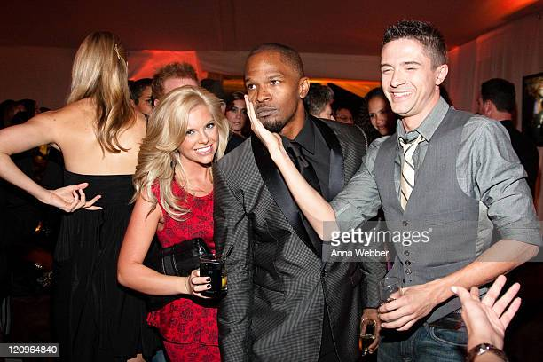 Jamie Foxx Topher Grace and guest attend L'Ermitage on January 29 2010 in Los Angeles California