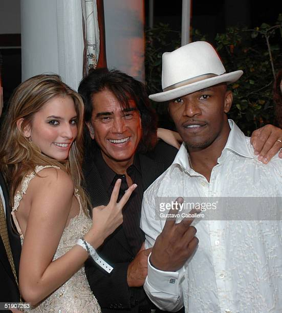 Jamie Foxx with singer El Puma and his daughter actress Genesis Rodriguez at a New Year's Eve party at the Delano Hotel on January 1 2005 in Miami...