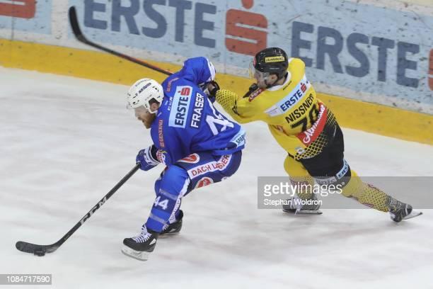 Jamie Fraser of Villach and Benjamin Nissner of Vienna during the Vienna Capitals v EC VSV Erste Bank Eishockey Liga at Erste Bank Arena on January...