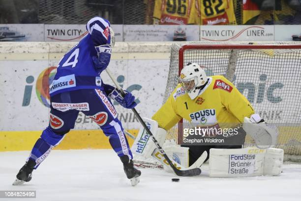 Jamie Fraser of Villach and JeanPhilippe Lamoureux of Vienna during the Vienna Capitals v EC VSV Erste Bank Eishockey Liga at Erste Bank Arena on...