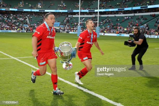 Jamie George and Richard Wigglesworth of Saracens celebrate with the trophy after winning the Gallagher Premiership Rugby Final between Exeter Chiefs...