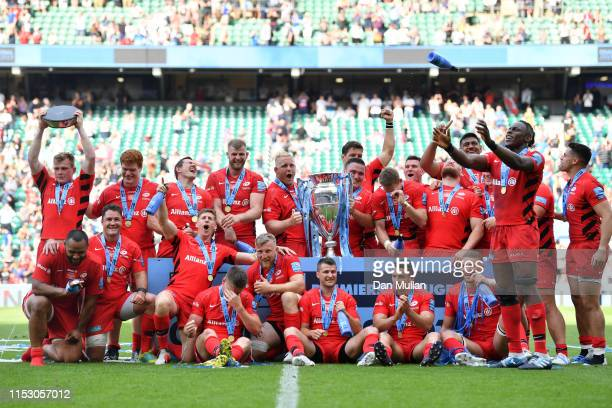 Jamie George and Vincent Koch of Saracens lift the trophy after winning the Gallagher Premiership Rugby Final between Exeter Chiefs and Saracens at...