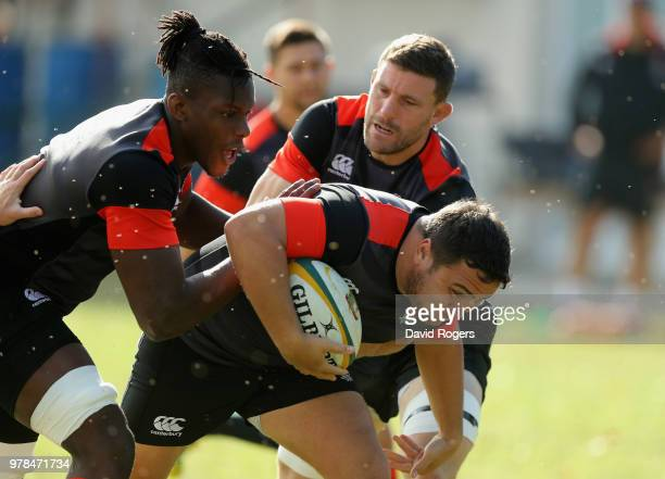 Jamie George charges upfield with Maro Itoje and Mark Wilson in support during the England training session held at Kings Park on June 19 2018 in...