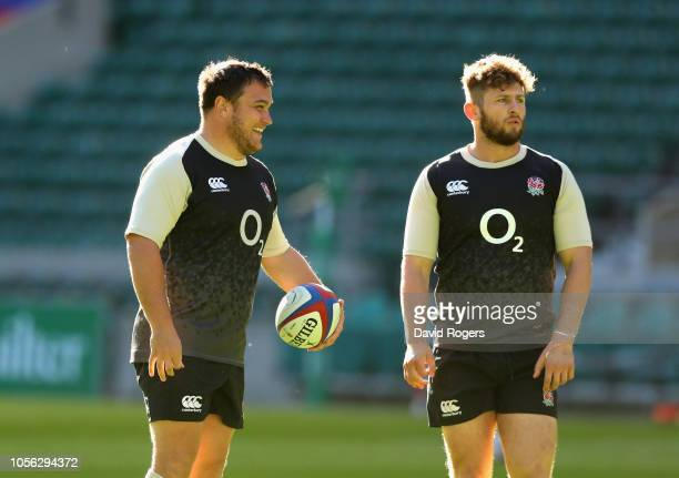 Jamie George looks on with team mate Alec Hepburn during the England captain's run held at Twickenham Stadium on November 2 2018 in London England
