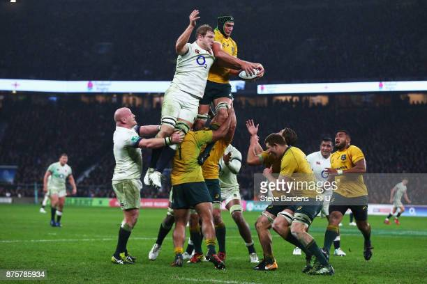 Jamie George of England an Rob Simmons of Australia jump during a line out during the Old Mutual Wealth Series match between England and Australia at...