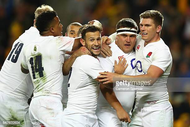 Jamie George of England celebrates scoring a try with team mates during the International Test match between the Australian Wallabies and England at...