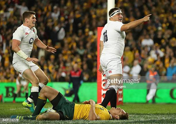 Jamie George of England celebrates with team mate Owen Farrell after scoring their fourth try during the International Test match between the...