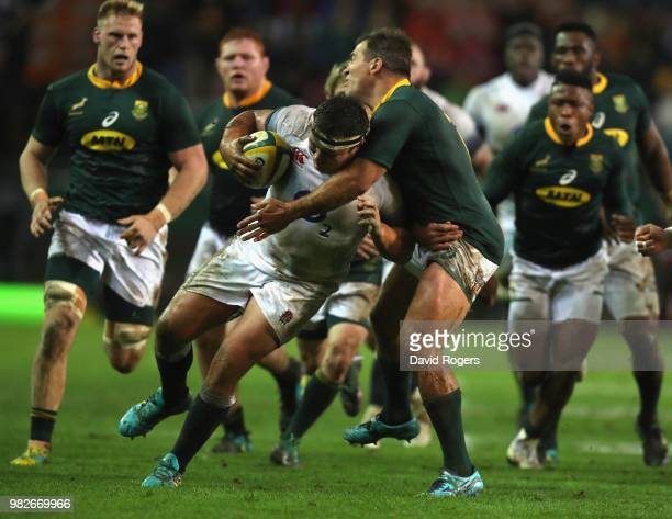 Jamie George of England is tackled by Schalk Brits during the third test match between South Africa and England at Newlands Stadium on June 23 2018...