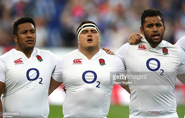 Jamie George of England lines up with team mates Mako Vunipola and Billy Vunipola during the International match between France and England at Stade...