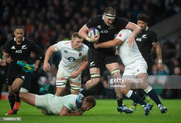 Jamie George of England tackles Brodie Retallick of New Zealand during the Quilter International match between England and New Zealand at Twickenham...