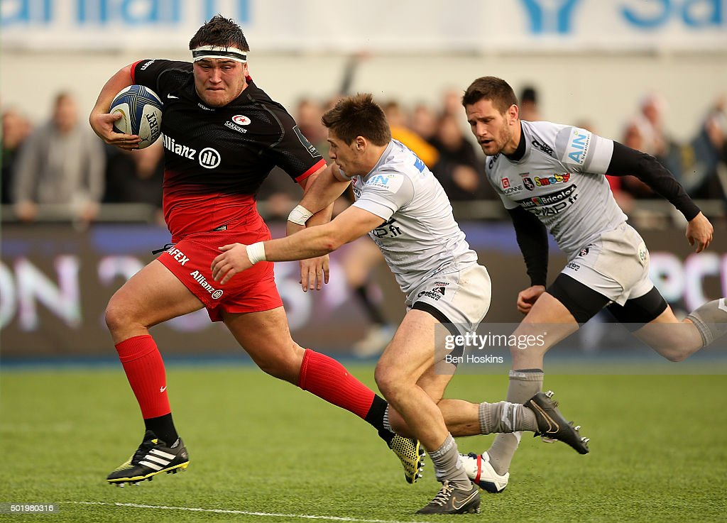 Jamie George of Saracens breaks away from Julien Blanc of Oyonnax to score a try during the European Rugby Champions Cup match between Saracens and Oyonnax at Allianz Park on December 19, 2015 in Barnet, England.