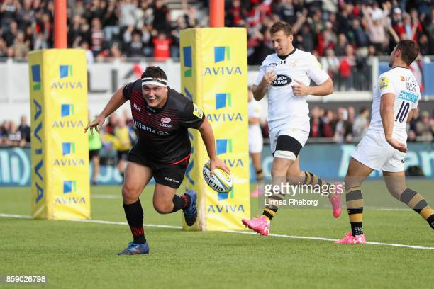 Jamie George of Saracens celebrates after scoring his first try of three during the Aviva Premiership match between Saracens and Wasps at Allianz...