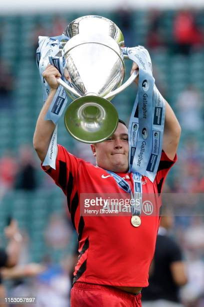 Jamie George of Saracens celebrates with the trophy following the Gallagher Premiership Rugby Final between Exeter Chiefs and Saracens at Twickenham...