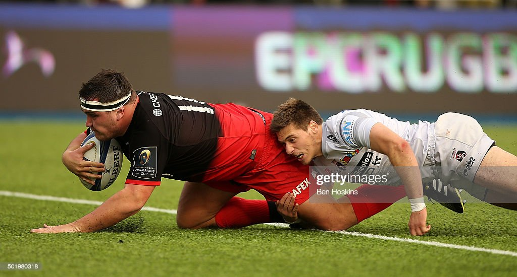 Jamie George of Saracens dives over to score a try under pressure from Julien Blanc of Oyonnax during the European Rugby Champions Cup match between Saracens and Oyonnax at Allianz Park on December 19, 2015 in Barnet, England.