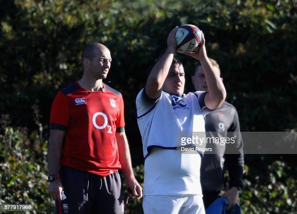 Jamie George the England hooker prepares to throw the ball as forwards coach Steve Borthwick looks on during the England training session held at...