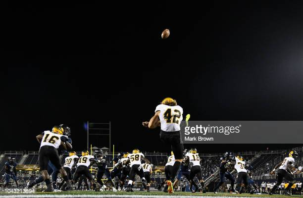 Jamie Gillan of the ArkansasPine Bluff Golden Lions kicks and 80 yard punt during the first half against the FIU Golden Panthers at Ricardo Silva...
