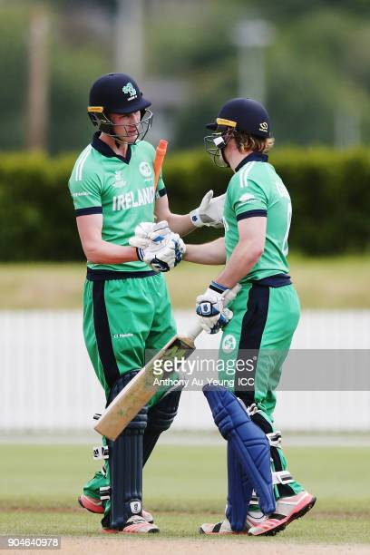Jamie Grassi of Ireland celebrates scoring a half century as captain Harry Tector congratulates him during the ICC U19 Cricket World Cup match...