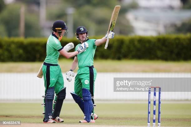 Jamie Grassi of Ireland celebrates scoring a half century during the ICC U19 Cricket World Cup match between Sri Lanka and Ireland at Cobham Oval on...