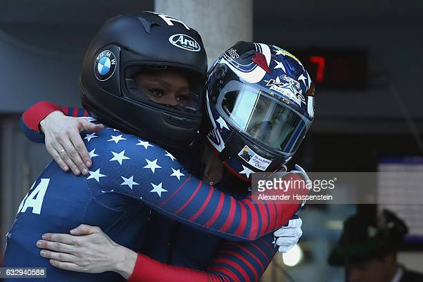 Jamie Greubel Poser and Aja Evans of USA celebrate after the Women's Bobsleigh second run of the BMW IBSF World Cup at Deutsche Post Eisarena...