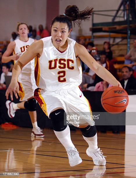 Jamie Hagiya of USC drives to the basket during 7660 victory over Arizona in Pacific10 Conference women's basketball game at the Lyon Center in Los...