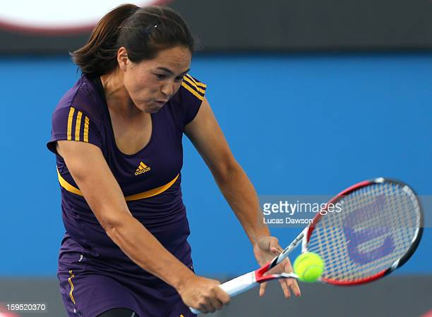 Jamie Hampton of the United States plays a backhand in her first round match against Urszula Radwanska of Poland during day two of the 2013...