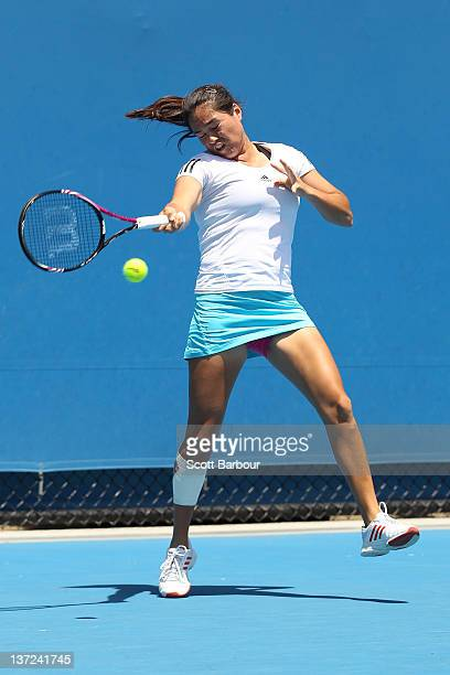 Jamie Hampton of the United States plays a forehand in her first round match against Mandy Minella of Luxembourg during day two of the 2012...