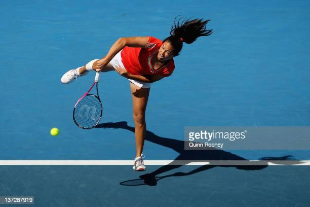 Jamie Hampton of the United States serves in her second round match against Maria Sharapova of Russia during day four of the 2012 Australian Open at...