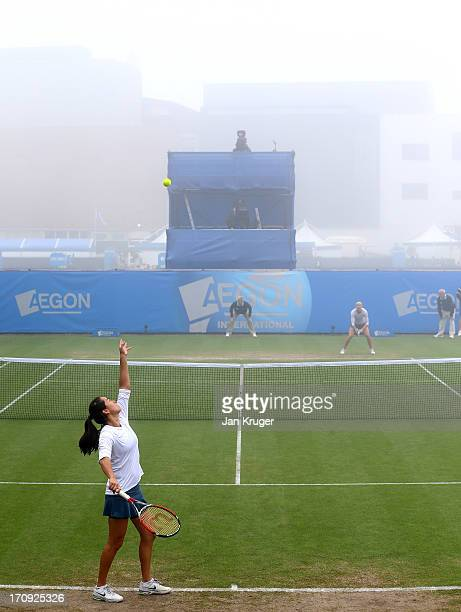 Jamie Hampton of the USA serves in the mist against Lucie Safarova of Czech Republic during day six of the AEGON International tennis tournament at...