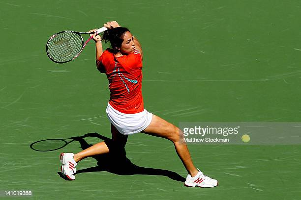 Jamie Hampton returns a shot to Jelena Jankovic of Serbia during the BNP Paribas Open at the Indian Wells Tennis Garden on March 9 2012 in Indian...