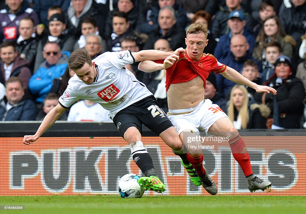 Jamie Hanson of Derby County and Ben Osborn of Nottingham Forest compete for the ball during the Sky Bet Championship match between Derby County and Nottingham Forest at the iPro Stadium on March 19, 2016 in Derby, United Kingdom.