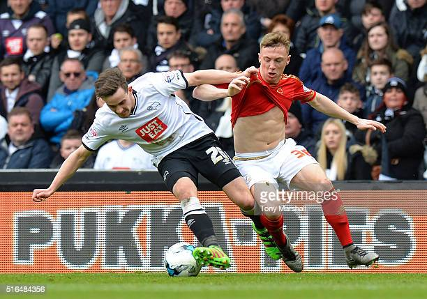 Jamie Hanson of Derby County and Ben Osborn of Nottingham Forest compete for the ball during the Sky Bet Championship match between Derby County and...